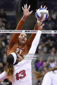 COLUMBUS, OH - DECEMBER 15:  Yaazie Bedart-Ghani #27 of the University of Texas blocks a ball hit from Briana Holman #13 of the University of Nebraska during the Division I Women's Volleyball Semifinals held at Nationwide Arena on December 15, 2016 in Columbus, Ohio.   Stanford beat Minnesota 3 sets to 1 in the other semifinal to advance to the finals. (Photo by Jamie Schwaberow/NCAA Photos via Getty Images)